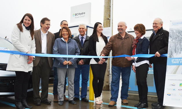 Minister of Energy and Mines and  Kootenay East MLA Bill Bennett is cutting the ribbon for the unveiling of the fast-charging station in a Cranbrook public parking lot.