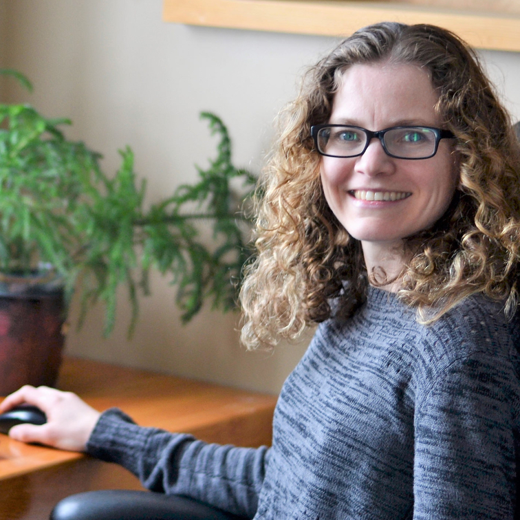 Alissa Bryden at her desk