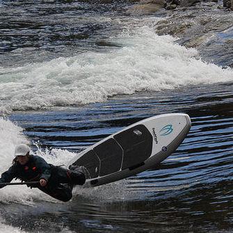 Andrea Ryman is SUP river surfing in Trail, B.C.