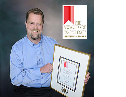 Jason Wheeldon holding a plaque