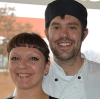 Chris Earle and Crystal Dillabough in front of the window at the newly opened Baker Street Cafe.