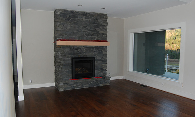 A fireplace in a basement.