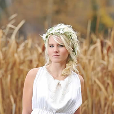 Picture of pretty bride with blonde hair standing in a wheat field