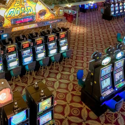 Picture of casino with slot machines.