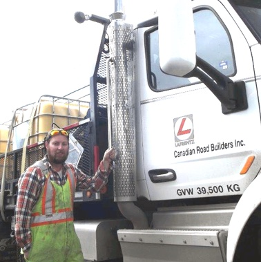 Kyle Procter gets ready to board his 18-wheel Peterbilt 485 to resume working as a road marker  for LaFrentz Road Marking,  a division of Canadian Road Builders Inc.
