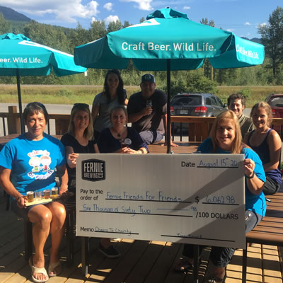 Employees of the Fernie Brewing Company hold up a cheque for the Fernie Friends for Friends.