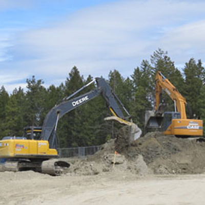 Heavy equipment breaking ground for the new Trade Building at the College of the Rockies.