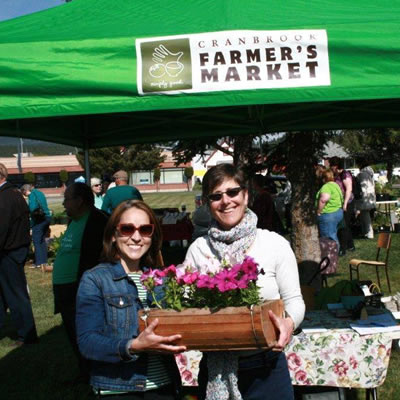 Picture of Livia Lara, new manager of the Cranbrook Farmer's Market, and Erna Jensen, previous manager.