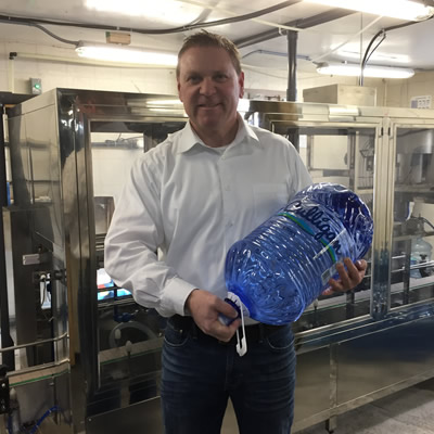 Murray Floyd displays a newly produced bottle from the company's new manufacturing facility in Cranbrook.
