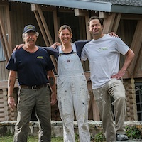 Dan Moberg, Kootenay Insulation Systems Ltd., Jenny Mitchell, White Ladder Painting, and  Darren Hatina,D's Drywall Inc. in front of a project designed and managed by Chernoff Architect Inc. and Crescent Consulting Ltd.