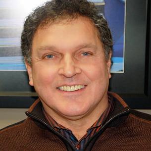 A portrait photo of Derek Spring.