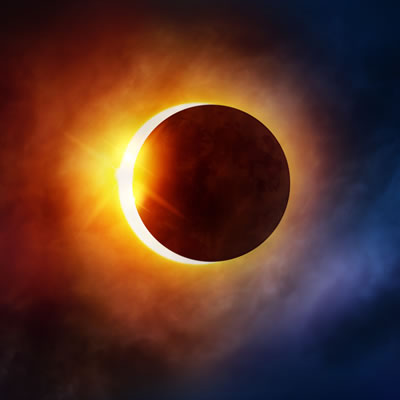 A photo of the moon covering most of the sun during a solar eclipse