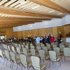 People gathered in the interior of a banquet hall.