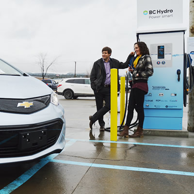 A Chevy Bolt is parked next to the newly unveiled DC fast-charging station in Cranbrook, B.C.