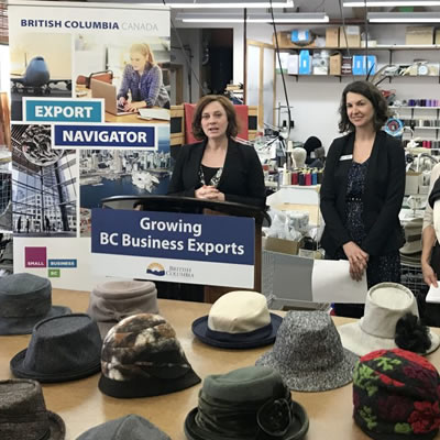 Michelle Mungall, MLA for Nelson-Creston, announces the extension of the Export Navigator Pilot Project. Also pictured, Andrea Wilkey, Executive Director, Community Futures Central Kootenay, Liz Cohoe, owner, Lillie and Cohoe, and Michael Hoher, Export Navigator advisor.