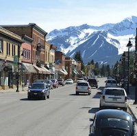 Downtown fernie with the backdrop of a snowy ski hill.