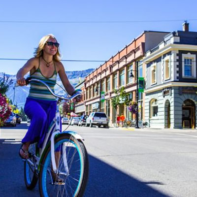 Girl on bike riding in downtown Fernie.
