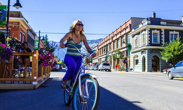 Girl on bike riding in downtown Fernie.