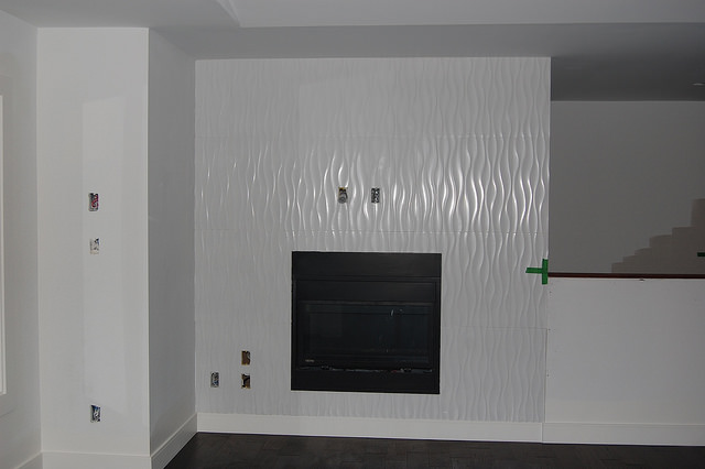 An example of a white contempary fireplace inset into a wall.