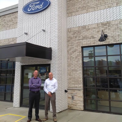 Picture of Doug Smith, manager of fixed operations at Fernie Ford and Andrew Moore, GM.
