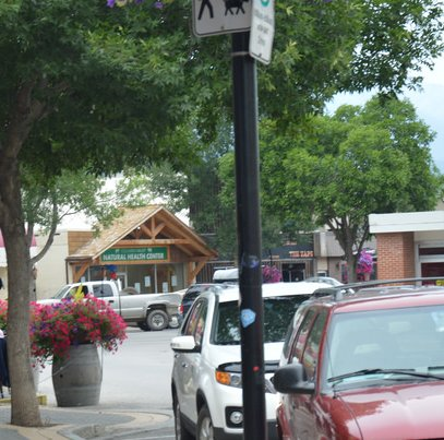 Flags and timberframe gateposts mark the entrance to Golden, B.C.