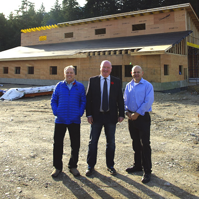 Alan Mason, Mark McKee and Daniel Kellie in front of new greeting centre for snowmobilers.
