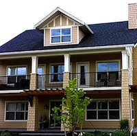 A two story craftsman style home.