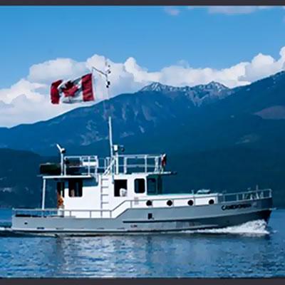 Houseboat flying Canadian flag on Kootenay Lake