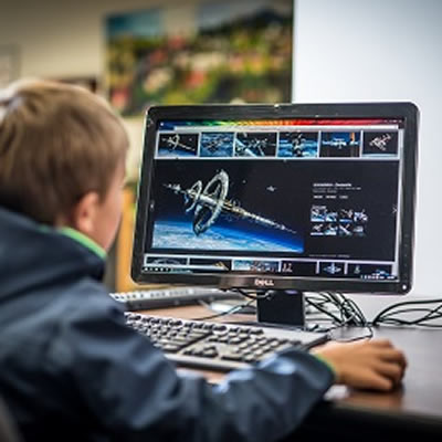 Picture of young boy using a computer.