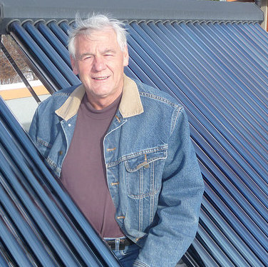 Jori Adank on the roof of his net zero energy (NZE) home in Kimberley, B.C.