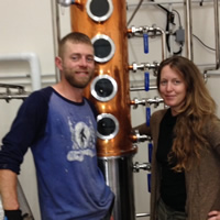 Kevin and Lora Goodwin with the still at Kootenay Country Craft Distillery.