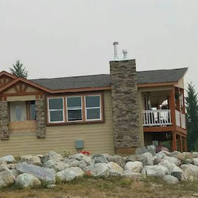 A home built by Kodiak Homes, set up on a property.