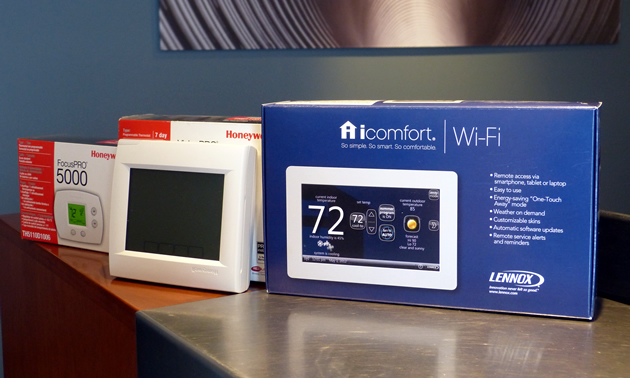 Three different types of programmable thermostats.