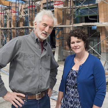 Russell Precious (left) and Deirdre Lang — co-project managers of the Nelson Commons development — stand in front of the nearly completed building that will serve as both a new store for the Kootenay Co-op and home to 54 condo owners.