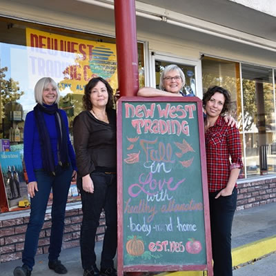 Connie Lawrence, owner of The New West Trading Co. 1985 in Grand Forks, is standing outside her store with three staff members.