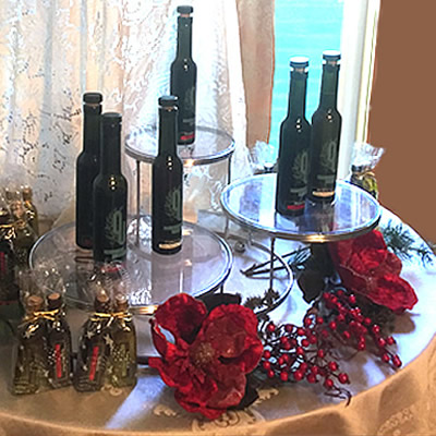 Picture of table with various bottles of olive oils on it.