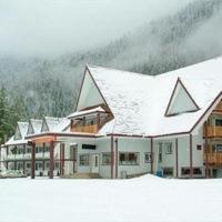 Peaks Lodge under snow in the winter.