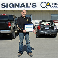D'Arcy Giberson standing in front of Signal Collision in Cranbrook.