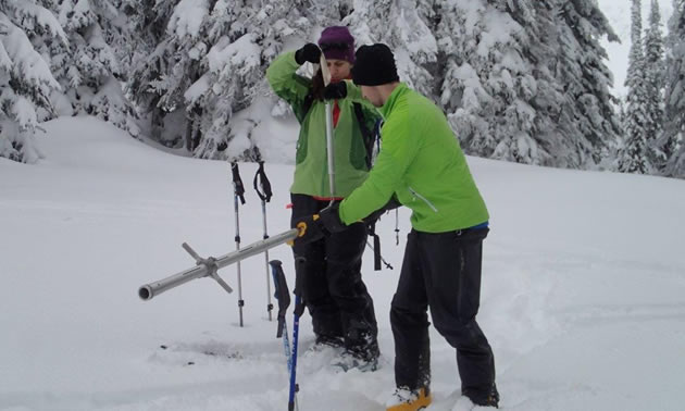 Volunteers with the North Kootenay Lake Water Monitoring Program measure the snowpack.