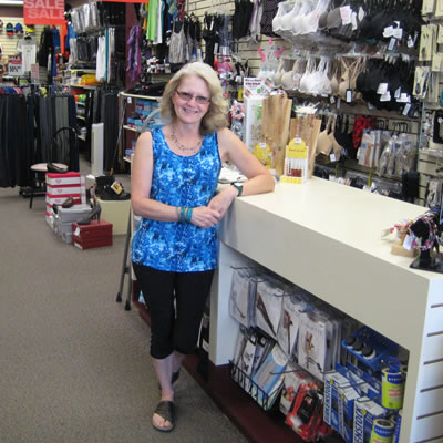 Owner of Sue's Clotheslines in Creston, Sue Thomas stands near her front counter.
