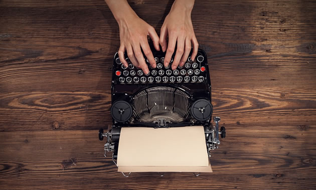 Picture of person using typewriter at top of picture, with laptop user below.
