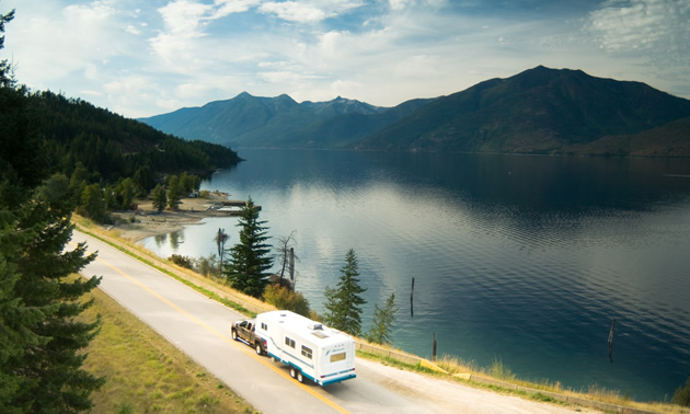 Picture of RV travelling along lakeshore road.