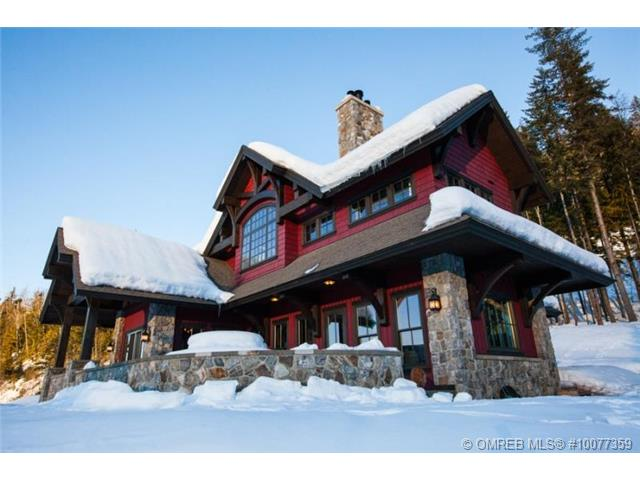 Snow covered luxury estate home offered at Revelstoke Mountain Resort.