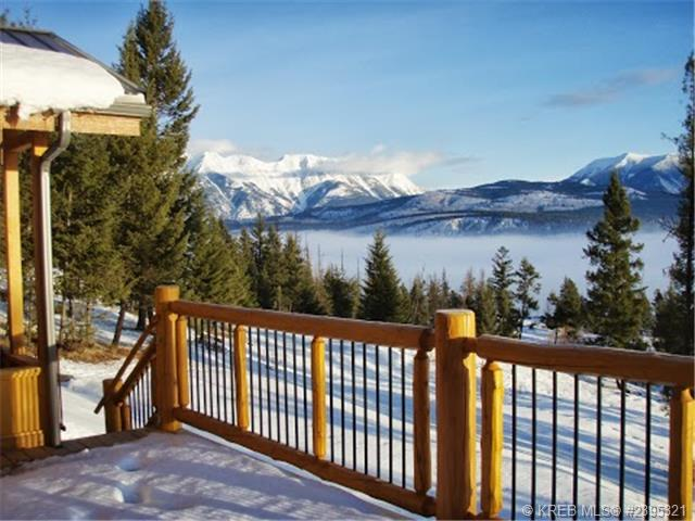 Looking off of the back deck on a fresh snowfall, with the sun sparkling on the snow and the mountains in the background.