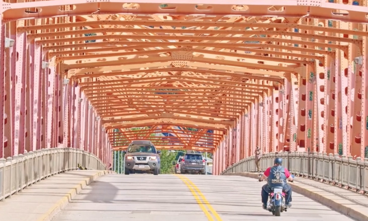 Brad Pommen rides down a highway in Nelson, B.C. on his Harley-Davidson Fat Boy motorcycle.