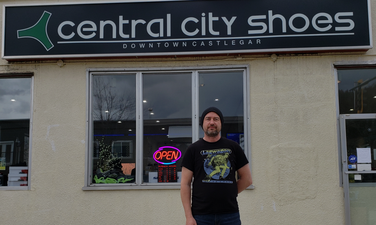 Derrek Kittson stands in front of his business, Central City Shoes.