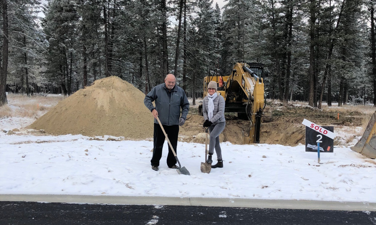 Clint Cawsey and Jody Charlton, turned sod on Lot 2 in Phase 1 of The Woodlands.