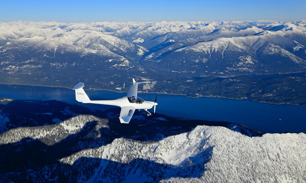 A Diamond HK36 self-launch glider soars over the Kootenays.