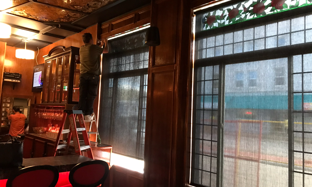SMART shades are being installed in a restaurant.