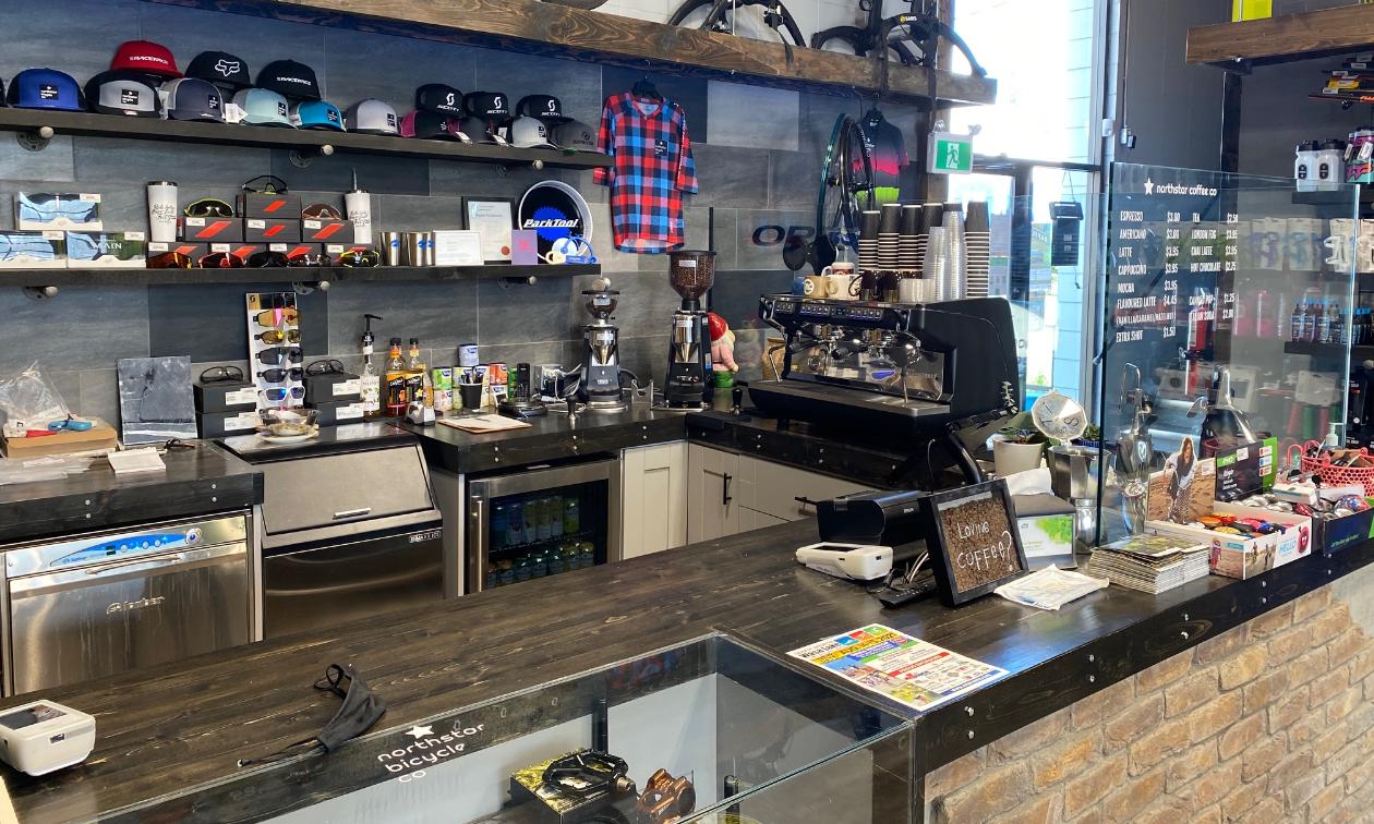 A coffee bar is set up inside a bike shop.